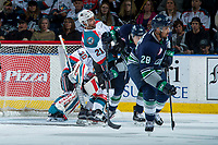 KELOWNA, CANADA - APRIL 25: Devante Stephens #21 of the Kelowna Rockets is checked in front of the net by Alexander True #16 of the Seattle Thunderbirds during first period on April 25, 2017 at Prospera Place in Kelowna, British Columbia, Canada.  (Photo by Marissa Baecker/Shoot the Breeze)  *** Local Caption ***