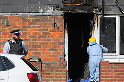 """© Licensed to London News Pictures. 07/08/2018. London, UK. The scene of a house fire in Deptford, east London, in which a 7 year-old boy has died. Six fire engines were called to a """"suspicious"""" fire in the early hours of Tuesday morning. Photo credit: Rob Pinney/LNP"""