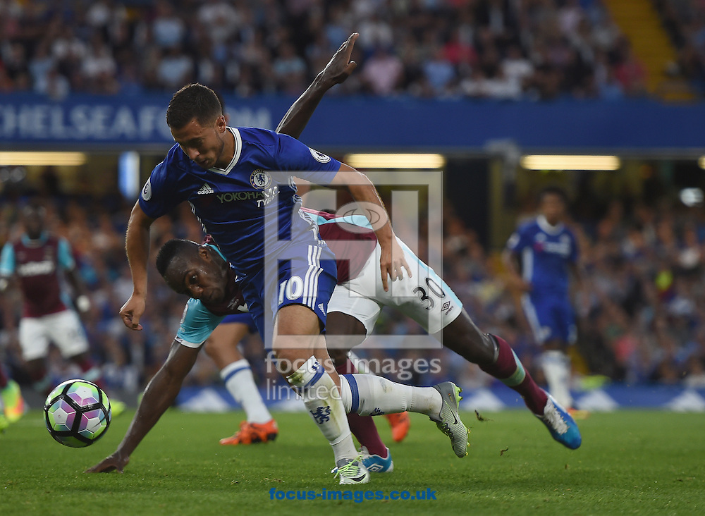 Chelsea's Eden Hazard and Michail Antonio of West Ham United during the Premier League match at Stamford Bridge, London<br /> Picture by Daniel Hambury/Focus Images Ltd +44 7813 022858<br /> 15/08/2016