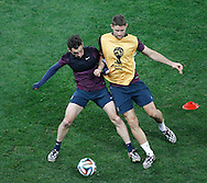 Leighton Baines (L) tackles Gary Cahill (R) during the England training session at Arena Corinthians, Sao Paulo, Brazil, on the eve of their World Cup 2014 Group D match against Uruguay.<br /> Picture by Andrew Tobin/Focus Images Ltd +44 7710 761829<br /> 18/06/2014
