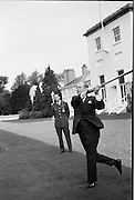 Having had a few lessons from All-Ireland winner Jack Lynch, King Baudouin of Belgium takes a puck at the sliotar in the grounds of the Áras an Uachtarain..17.05.1968