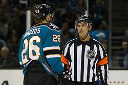 Dec 8, 2011; San Jose, CA, USA; San Jose Sharks center Michal Handzus (26) talks with NHL referee Wes McCauley (4) during the first period against the Dallas Stars at HP Pavilion.  San Jose defeated Dallas 5-2. Mandatory Credit: Jason O. Watson-US PRESSWIRE