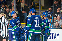 KELOWNA, BC - SEPTEMBER 29:  Brock Boeser #6, Alexander Edler #23, Troy Stecher #51 and Nikolay Goldobin #77 of the Vancouver Canucks stand at the boards to celebrate a goal against the Arizona Coyotes at Prospera Place on September 29, 2018 in Kelowna, Canada. (Photo by Marissa Baecker/NHLI via Getty Images)  *** Local Caption *** Nikolay Goldobin;Brock Boeser;Alexander Edler;Troy Stecher