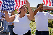 "01 MAY 2006 - PHOENIX, AZ: About 1000 immigrants gathered on a street corner in Phoenix at a Home Depot store during a protest in favor of immigration reform during the ""Day without Immigrants"" protest in Phoenix. About 1,000 people picketed the corner, which had been a popular gathering spot for day laborers until Home Depot took action to keep day laborers off their property. Immigrants rights groups picketed two Home Depot stores, a pallet manufacturing plant and a public school during the protest. Photo by Jack Kurtz"