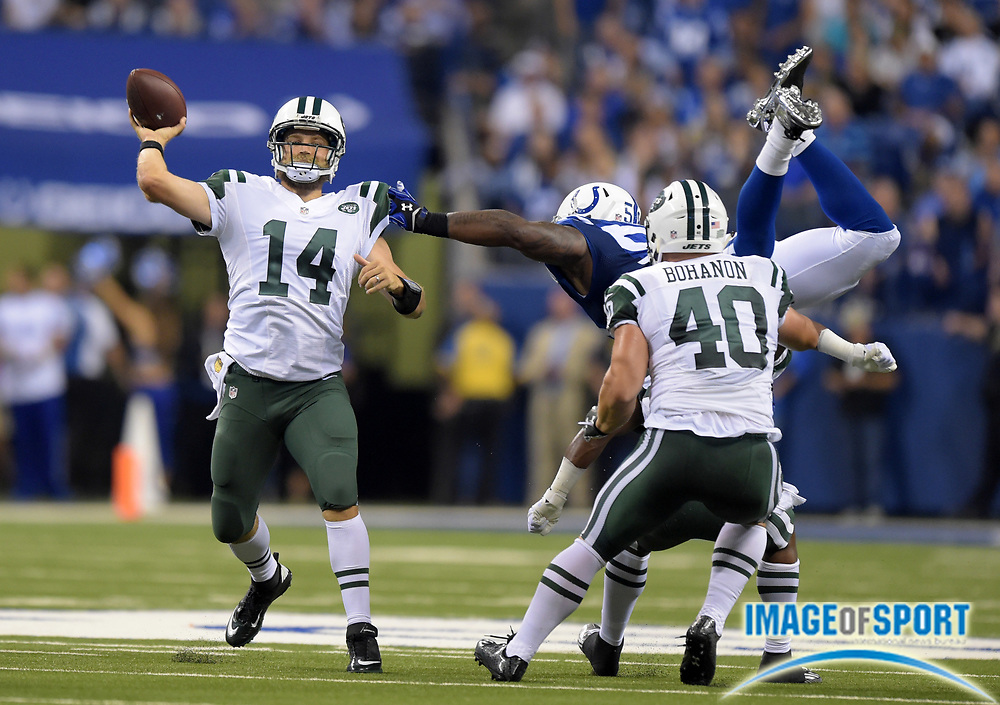 Sep 21, 2015; Indianapolis, IN, USA; New York Jets quarterback Ryan Fitzpatrick (14) throws a pass during an NFL football game against the Indianapolis Colts  at Lucas Oil Stadium.