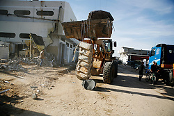 Rubble is removed from a home destroyed by Israel in the Ezbat Abed Rabu neighborhood of Jabaliya in the Gaza Strip.