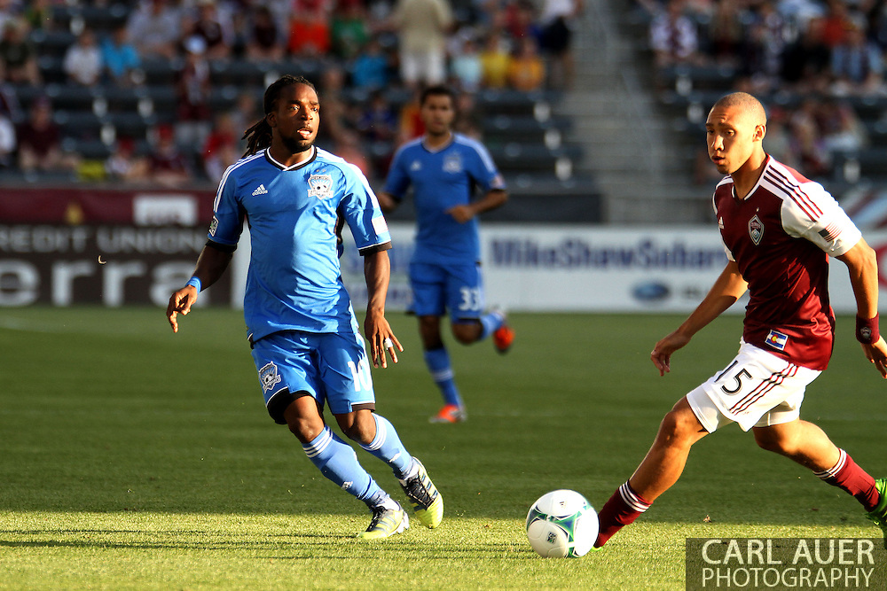 June 15th, 2013 - San Jose Earthquake midfielder Walter Martinez (10) gets the ball past Colorado Rapids defender Chris Klute (15) in the first half of action in the MLS match between San Jose Earthquake and the Colorado Rapids at Dick's Sporting Goods Park in Commerce City, CO