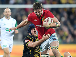 """Iain Henderson of the Lions, right, tackled by Mark Abbott of the Hurricanes in the International rugby match between the the Super Rugby Hurricanes and British and Irish Lions at Westpac Stadium, Wellington, New Zealand, Tuesday, June 27, 2017. Credit:SNPA / Ross Setford  **NO ARCHIVING"""""""