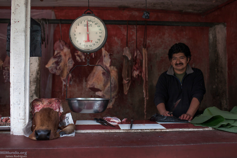 Portrait of a butcher in his shop. Santa Maria Chiquimula, Totonicapan, Guatemala. October 25, 2014.