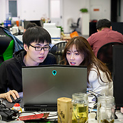 Nai Nai, a 23-year-old live-streamer in Shanghai, China, talks with her agent Wang Jianbing. 