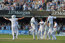 © Licensed to London News Pictures. 21/07/2013. Graeme Swann (centre) celebrates taking the wicket of Pattinson to win the 2nd test on day 4 of the Second Test England v Australia The Ashes Lord's Cricket Ground, London on July 21, 2013. England won the match taking a 2 - 0 lead in the series. Photo credit: Mike King/LNP