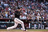 Apr 22, 2017; Phoenix, AZ, USA; Arizona Diamondbacks catcher Chris Herrmann (10) hits a two run homer in the fourth inning against the Los Angeles Dodgers at Chase Field. Mandatory Credit: Jennifer Stewart-USA TODAY Sports