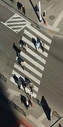 BRUSSELS, BELGIUM - APRIL-04-2007 - Aerial view of pedestrian crossing a street in a cross-walk.(Photo © Jock Fistick)