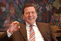 09 JAN 2002, BERLIN/GERMANY:<br /> Gerhard Schroeder, SPD, Bundeskanzler, waehrend einem Interiew, in seinem Buero, Bundeskanzleramt<br /> Gerhard Schroeder, SPD, Federal Chancellor of Germany, during an interview, in his office<br /> IMAGE: 20020109-02-022<br /> KEYWORDS: Gerhard Schr&ouml;der, lacht, Lachen