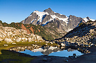 Mount Shuksan reflected in a tarn near Artist Point in the Mount Baker-Snoqualmie National Forest, Washington State, USA.