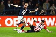09-04-2016 VOETBAL:PSV:WILLEM II:EINDHOVEN<br /> Frank van der Struijk van Willem II in duel met Gaston Pereiro van PSV<br /> Foto: Geert van Erven