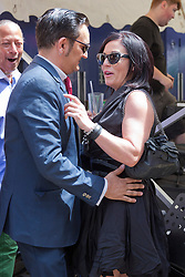 © Licensed to London News Pictures. 06/07/2014. London, England. Singer Tom Arnold (The Soho Hobo) with his girlfriend actress Jessie Wallace (EastEnders). Celebrities attend the 65th Anniversary Celebrations of Bar Italia in Frith Street, Soho, London, in aid of Great Ormond Street Hospital. Photo credit: Bettina Strenske/LNP
