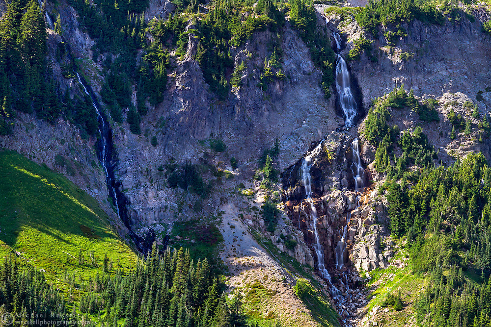 Waterfalls on the edge of a glacial trough created by the Nisqually Glacier on Mount Rainier - Mount Rainier National Park, Washington State, USA