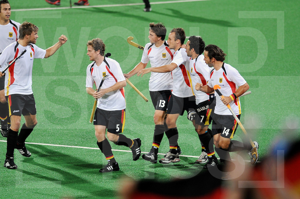 Beijing Olympic Green Hockey Stadium - Hockey.Korea vs Germany  men 3-3.German celebration after the 1-2 by Matthias Witthaus..Moritz Fürst, Sebastian Biederlack, Tobias Hauke, witthaus and Tibor Weissenborn..photo:wsp/Frank Uijlenbroek.