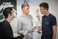 © Licensed to London News Pictures . 18/08/2016 . Wigan , UK . Three students check the UCAS website after reading their results . Students at Winstanley College in Wigan collect their A-Level results . Photo credit: Joel Goodman/LNP
