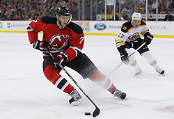 Jan 4, 2012; Newark, NJ, USA; New Jersey Devils defenseman Henrik Tallinder (7) skates with the puck while being defended by Boston Bruins right wing Shawn Thornton (22) during the first period at the Prudential Center.