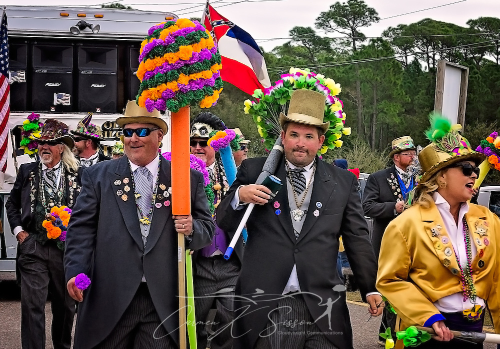 Members of the Ole Biloxi Marching Club participate in the Krewe de la Dauphine Mardi Gras Parade, Jan. 28, 2017, in Dauphin Island, Alabama. The club, which was established in 1975, gives carnations and kisses to women and children along the parade route. (Photo by Carmen K. Sisson/Cloudybright)
