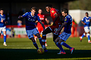 Matt Willock of Crawley Town is tackled by Stelios Demetriou of Macclesfield Town during the EFL Sky Bet League 2 match between Crawley Town and Macclesfield Town at The People's Pension Stadium, Crawley, England on 23 February 2019.