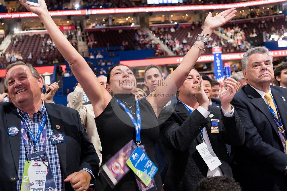 New York delegates celebrate the nomination of Donald Trump during the second day of the Republican National Convention July 19, 2016 in Cleveland, Ohio. The delegates formally nominated Donald J. Trump for president after a state by state roll call.