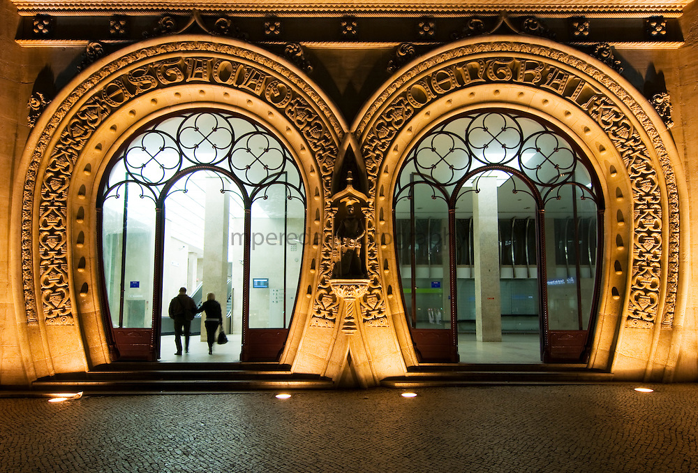 Ornate carved entrance portico to Rossio train station in Lisbon