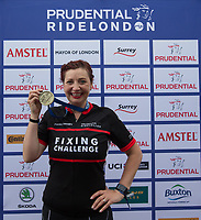 Cherry Kelly with her medal after completing The London-Surrey 100 during Prudential RideLondon on 30th July 2017<br /> <br /> Photo: Richard Washbrooke/Silverhub for Prudential RideLondon<br /> <br /> Prudential RideLondon is the world's greatest festival of cycling, involving 100,000+ cyclists – from Olympic champions to a free family fun ride - riding in events over closed roads in London and Surrey over the weekend of 28th to 30th July 2017. <br /> <br /> See www.PrudentialRideLondon.co.uk for more.<br /> <br /> For further information: media@londonmarathonevents.co.uk