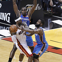 21 June 2012: Miami Heat small forward LeBron James (6) is double teamed by Oklahoma City Thunder center Kendrick Perkins (5) and Oklahoma City Thunder guard James Harden (13) during the Miami Heat 121-106 victory over the Oklahoma City Thunder, in Game 5 of the 2012 NBA Finals, at the AmericanAirlinesArena, Miami, Florida, USA. The Miami Heat wins the series 4-1.