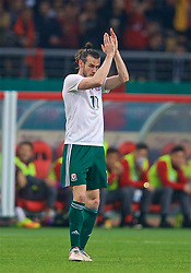 NANNING, CHINA - Thursday, March 22, 2018: Wales' Gareth Bale applauds the supporters as he is substitute after scoring the sixth goal, his third to complete his hat-trick, during the opening match of the 2018 Gree China Cup International Football Championship between China and Wales at the Guangxi Sports Centre. (Pic by David Rawcliffe/Propaganda)