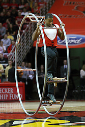 12 January 2013:   Cornell Freeney of the Gamma Phi Circus cast performs on the German Wheel during halftime at an NCAA Missouri Valley Conference mens basketball game featuring the Bulldogs of Drake University and the Illinois State Redbirds in Redbird Arena, Normal IL