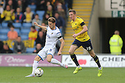 AFC Wimbledon midfielder Jake Reeves (8) releases the ball during the Sky Bet League 2 match between Oxford United and AFC Wimbledon at the Kassam Stadium, Oxford, England on 10 October 2015.