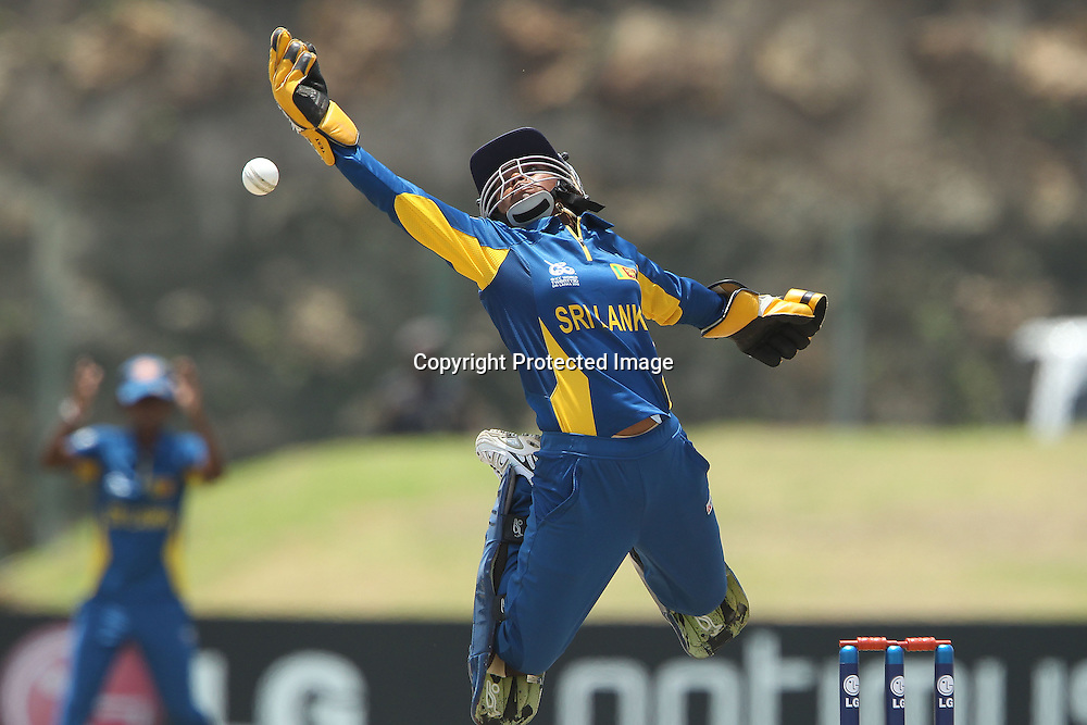 Dilani Manodara leaps to stop the ball during the ICC Women's World Twenty20 - 1st Match, Group B, between South Africa and Sri Lanka held at the Galle International Stadium in Galle, Sri Lanka on the 26th September 2012<br /> <br /> Photo by Ron Gaunt/SPORTZPICS