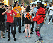 People dancing, partying, and have a good time at Lee Jones's open air Sundae dance party in 2009. This weekly event is held at the the Piazza at Schmidt's in Northern Liberties in Philadelphia each Sunday. Photos in this group are from Sundae with Dave P. and Jay Yo.