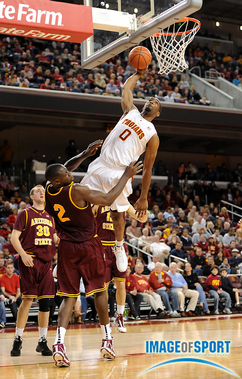 Jan 2, 2009; Los Angeles, CA, USA; Southern California Trojans forward Marcus Johnson (0) goes up for a dunk as Arizona State Sun Devils center Eric Boateng (2) defends at the Galen Center. USC defeated Arizona State 47-37.