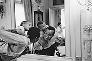 Harry belafonte relaxing with his son David in front of the mirror in Hotel Raphael, Paris.<br />
