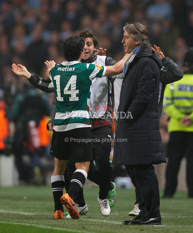 MANCHESTER, ENGLAND - Thursday, March 15, 2012: Sporting Clube de Portugal's Matias Fernandez celebrates scoring the first goal against Manchester City as manager Roberto Mancini looks on dejected during the UEFA Europa League Round of 16 2nd Leg match at City of Manchester Stadium. (Pic by David Rawcliffe/Propaganda)