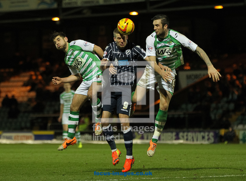 Steve Morison (centre) of Millwall heads the ball away from Joe Edwards (left) and Shane Duffy (right) of Yeovil Town during the Sky Bet Championship match at Huish Park, Yeovil<br /> Picture by Tom Smith/Focus Images Ltd 07545141164<br /> 11/02/2014