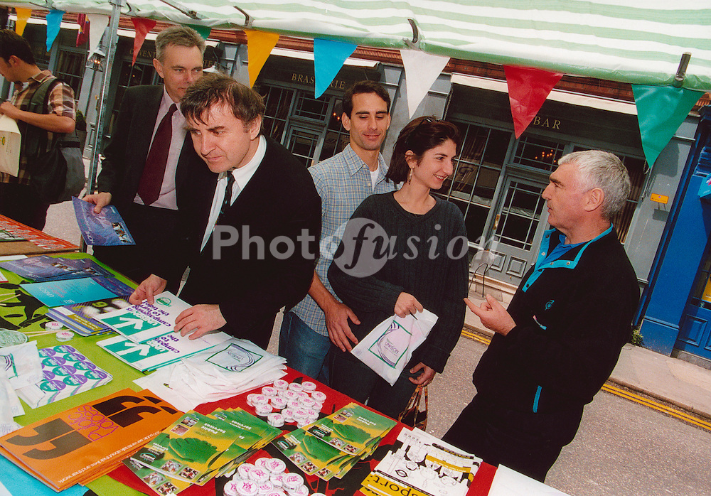 Trade Unionist lobbying a member of the public on 'Don't choke Britain day' to promote green transport