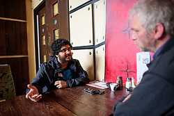 © London News Pictures. 12/10/2016. London, UK. Gay activist Sohail Ahmed, who turned his back on the extreme islamic movement Salafi. Sohail, who was raised in a hardline Islamist household, struggled throughout his youth with doubt about Islam, which conflicted with his sexuality. Pictured talking to reporter Jan Stevens. Photo credit: Ben Cawthra/LNP