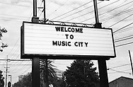A billboard welcoming visitors to Nashville, a city filled with music and world capitol of Country and Western music. Nashville, 2004