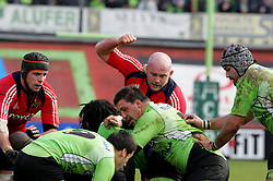 John Hayes punches a Montauban player in order to get them to release the ball from the scrum. Montauban v Munster,  Heineken Cup Pool A match in Montauban, France.