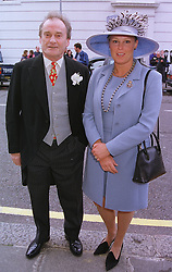 VISCOUNT & VISCOUNTESS GORMANSTON he is the premier Viscount of Ireland, at a wedding in London on 5th June 1999.MSW 61