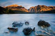 Sunrise light bathes the peaks above Phelps Lake in Grand Teton National Park, Jackson Hole, Wyoming.