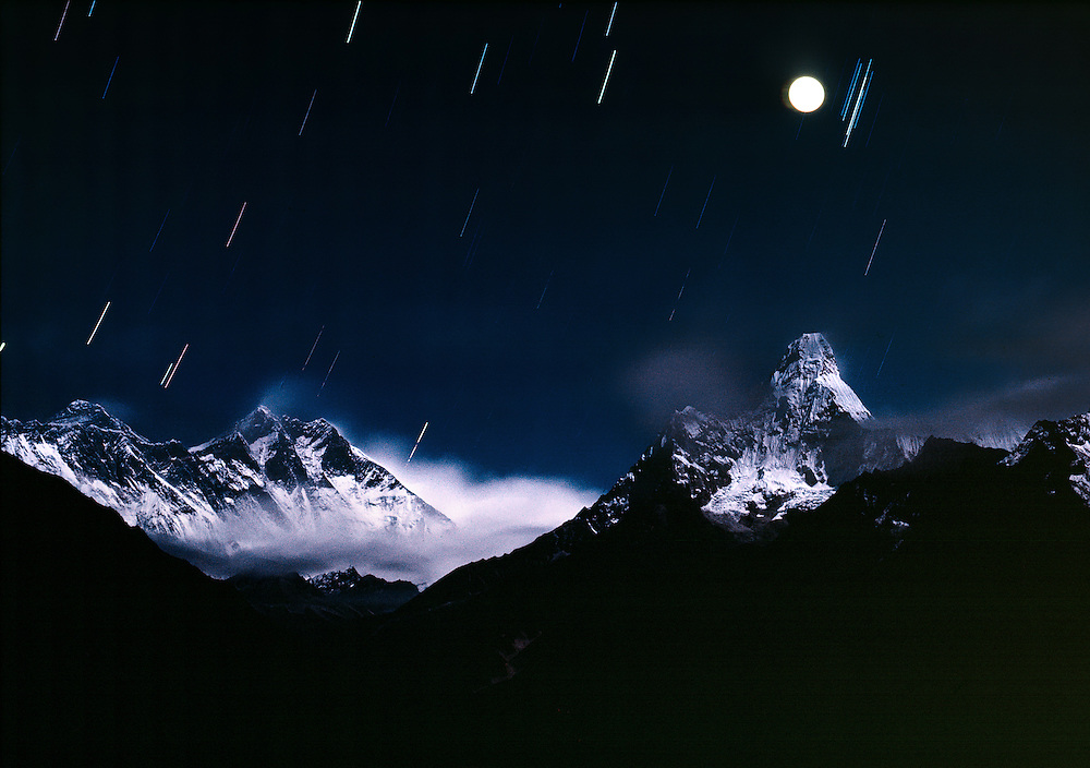 A star trail over Mount Everest appears in the Khumbu Himalaya in Everest, or Sagarmatha, National Park, Nepal.