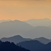 View of the rolling mountain peaks of Khaeng Krachan National Park at daw. Khaeng Krachan is Thailand.'s largest National Park.