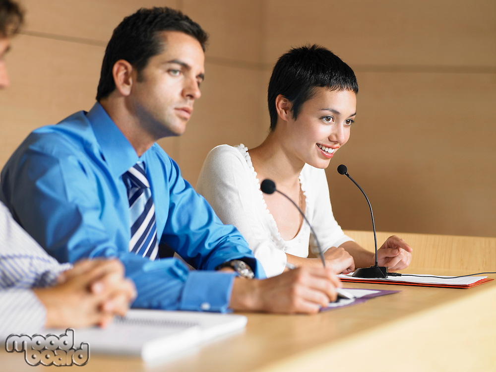 Three businesspeople at Panel Presentation