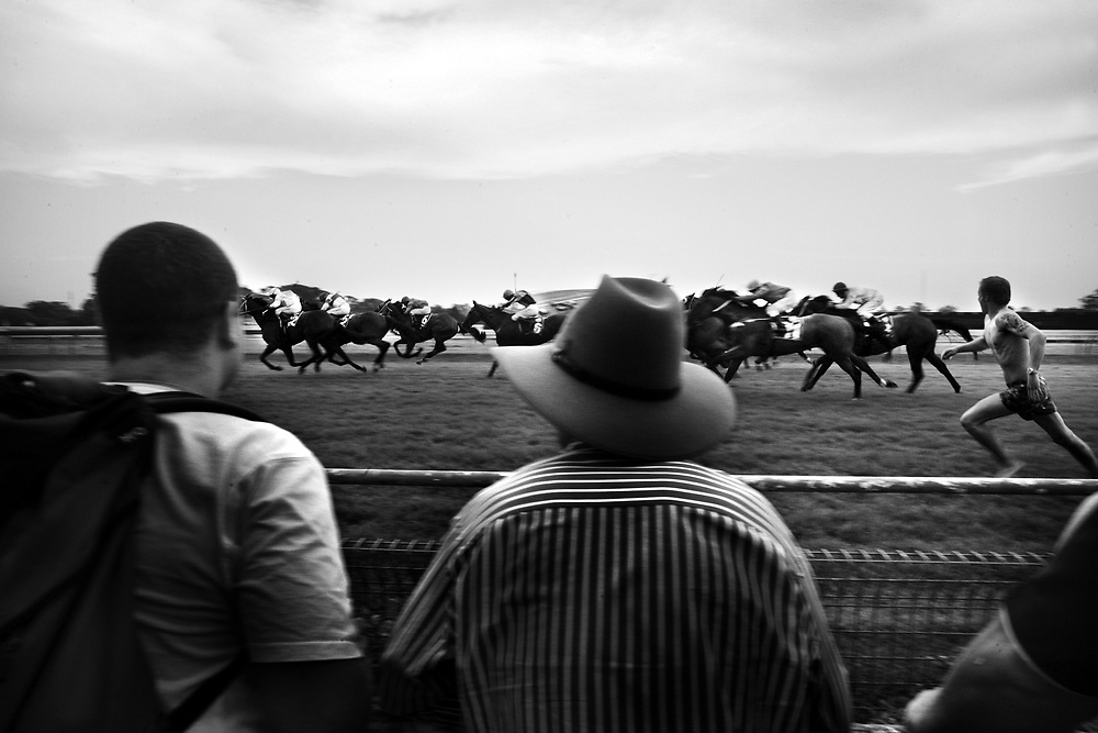 AT THE RACES, A streaker runs on to the track during the running of a race at Warwick Farm, near Sydney, Australia.